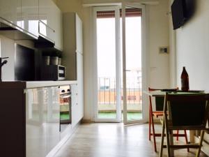 vista cucina + balcone